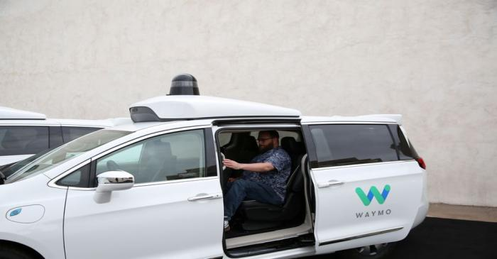 FILE PHOTO: Early rider Alex Hoffman seen inside a Waymo self-driving vehicle, during a