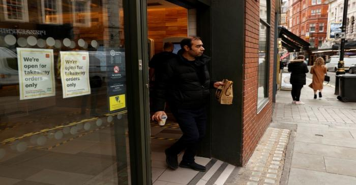 A man leaves a McDonald's restaurant in London