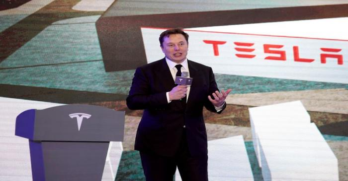 FILE PHOTO: Tesla Inc CEO Elon Musk speaks at an opening ceremony for Tesla China-made Model Y