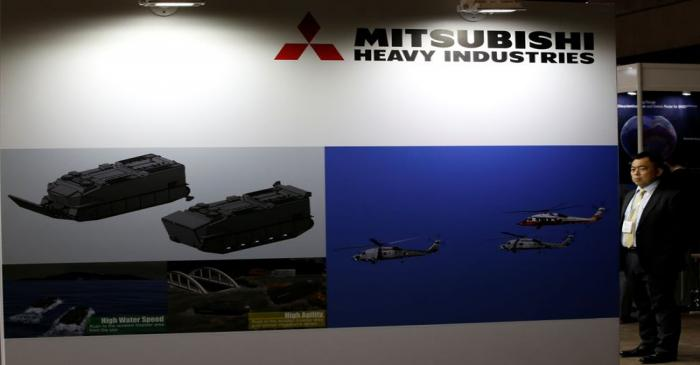 Visitor is seen at Mitsubishi Heavy Industries' booth during the MAST show in Chiba