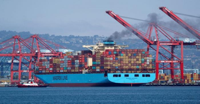 A Maersk Line container ship prepares to depart port in Long Beach, California