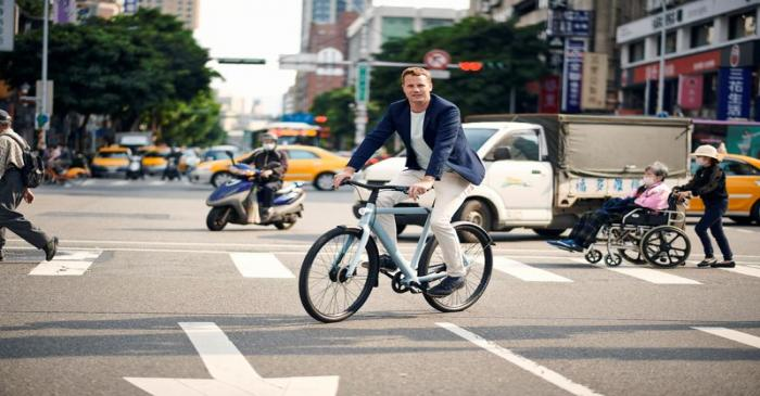 Ties Carlier, co-founder of Dutch electric bike maker Vanmoof, rides a bike