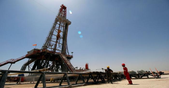 FILE PHOTO: Men work for Iraqi Drilling Company at Rumaila oilfield in Basra