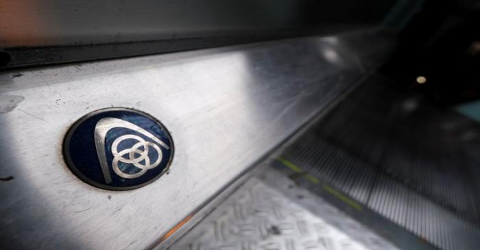 FILE PHOTO: The logo of German steelmaker ThyssenKrupp AG is seen on an escalator at