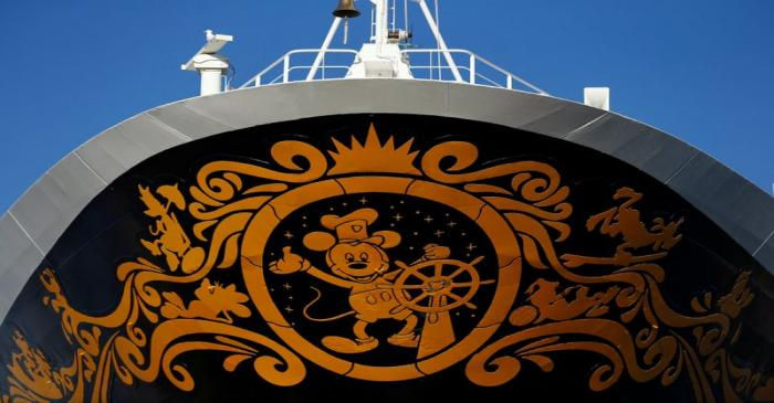 FILE PHOTO: Cartoon character Mickey Mouse is seen on the bow of the Disney Wonder cruise ship