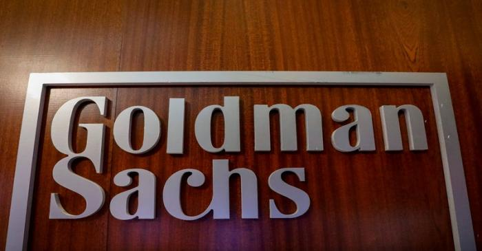 FILE PHOTO: The Goldman Sachs company logo is seen in the company's space on the floor of the