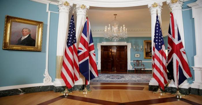 The flags of the United States and the United Kingdom stand after bi-lateral photo between U.S.