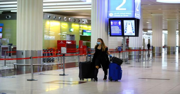 FILE PHOTO: Dubai International airport resumed limited outbound passenger flights amid