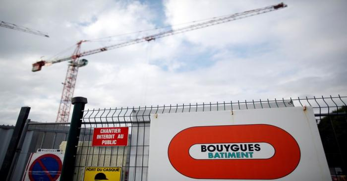 A construction crane is seen near the logo of French construction group Bouygues in Nantes