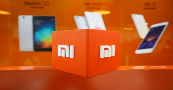 FILE PHOTO: The logo of Xiaomi is seen inside the company's office in Bengaluru, India