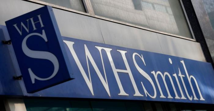 A company logo is pictured outside a branch of WH Smith in Manchester northern England.