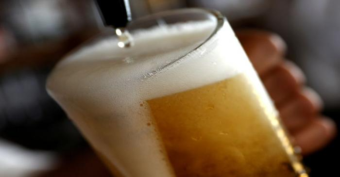 FILE PHOTO: A pint of beer is poured into a glass in a bar in London