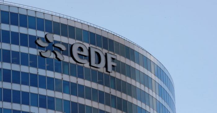 A logo of French electric company EDF is seen at an office building in La Defense business