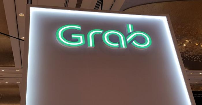 A Grab logo is pictured at the Money 20/20 Asia Fintech Trade Show in Singapore