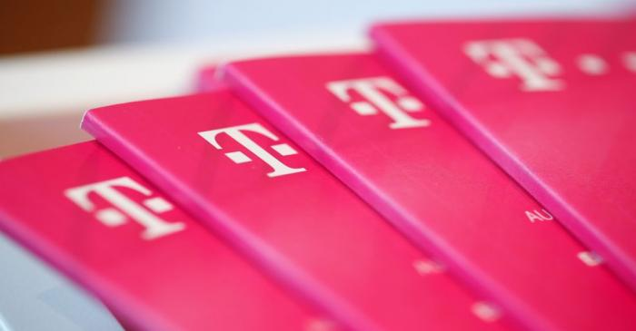 Brochures with the logo of Deutsche Telekom AG are pictured at the shop in the headquarters of