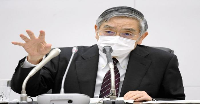 FILE PHOTO: Bank of Japan Governor Haruhiko Kuroda wearing a protective face mask attends a