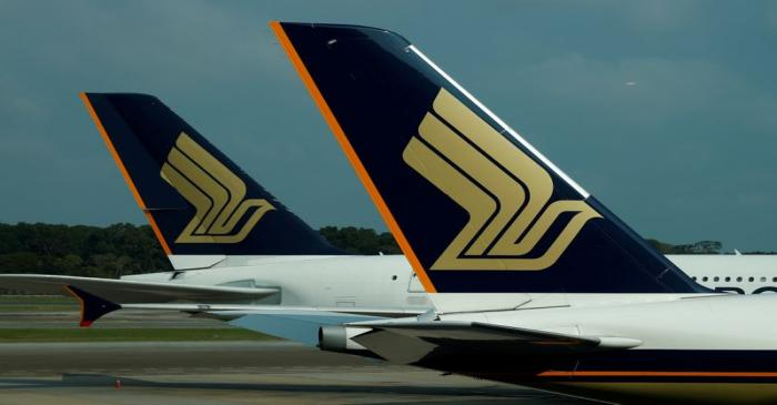 FILE PHOTO: Singapore Airlines planes sit on the tarmac at Singapore's Changi Airport