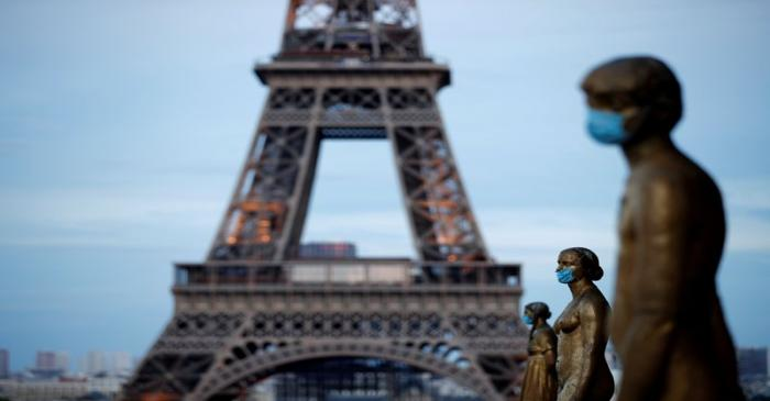 FILE PHOTO: Golden Statues at the Trocadero square near the Eiffel tower wear protective masks