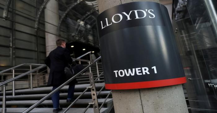 FILE PHOTO: A worker enters the Lloyd's of London building in the City of London financial