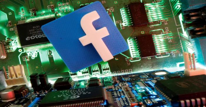 FILE PHOTO: Facebook symbol is seen on a motherboard in this picture illustration
