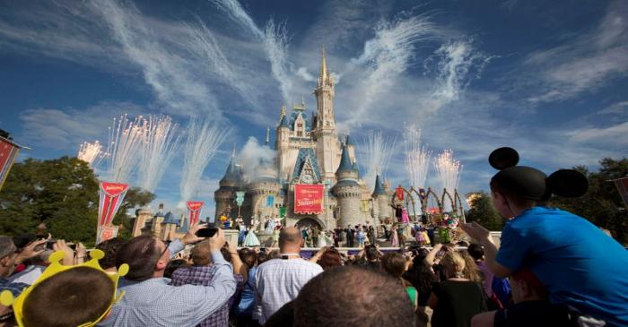 FILE PHOTO: Fireworks go off around Cinderella's castle during the grand opening ceremony for