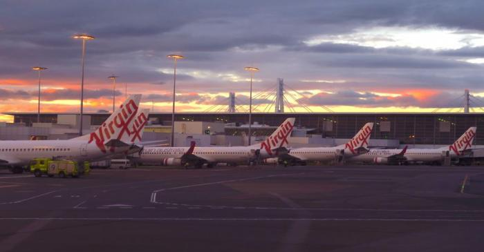 FILE PHOTO: Aircraft from Australia's second largest airline, Virgin Australia, sit on the