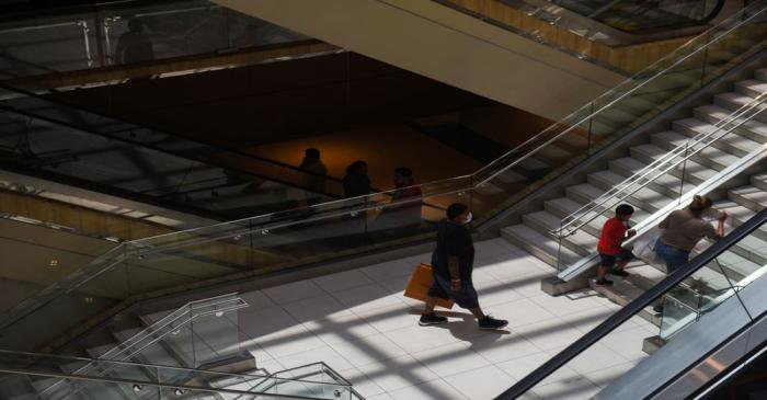 Crowds shop at The Galleria as social distancing guidelines to curb the spread of the