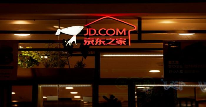FILE PHOTO: A sign of China's e-commerce company JD.com is seen at its shop at a mall in
