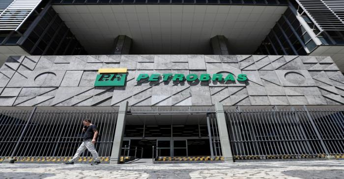 FILE PHOTO: A man walks in front of the headquarters of Petroleo Brasileiro S.A. (Petrobas) in