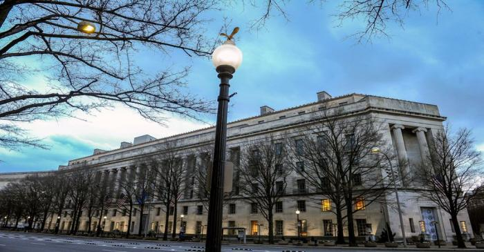 FILE PHOTO: The U.S. Department of Justice building is bathed in morning light at sunrise in