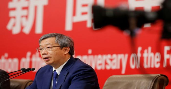 Governor of People's Bank of China (PBOC) Yi Gang attends a news conference on China's economic