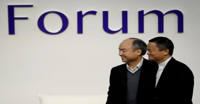 FILE PHOTO: SoftBank Group founder and CEO Masayoshi Son and Alibaba founder and former
