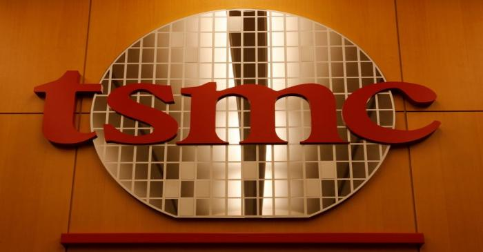 FILE PHOTO: A logo of Taiwan Semiconductor Manufacturing Co (TSMC) is seen at its headquarters