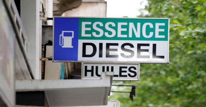 FILE PHOTO:  Signs at a petrol station indate Gas, Diesel, and Oil for vehicles in Paris