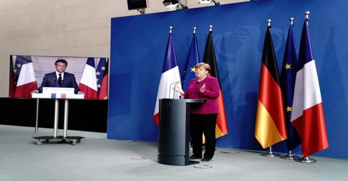 German Chancellor Angela Merkel holds a joint video news conference with French President