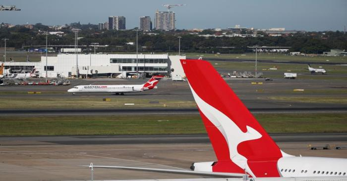 FILE PHOTO: Qantas planes are seen at Kingsford Smith International Airport in Sydney