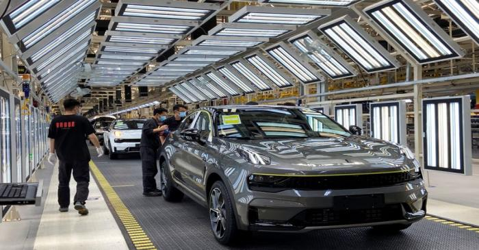 Employees wearing face masks work on a Lynk &Co car production line at Geely's Yuyao plant in