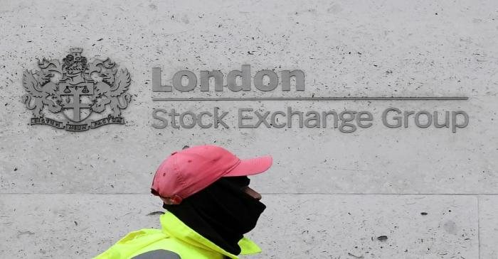 FILE PHOTO: A street cleaning operative walks past the London Stock Exchange Group building in