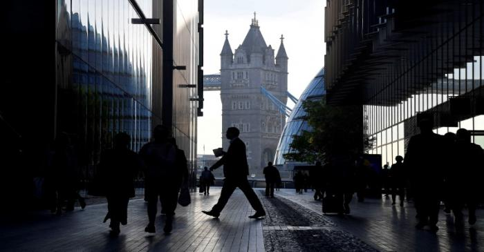FILE PHOTO: Workers are seen in the More London district, with Tower Bridge behind during the