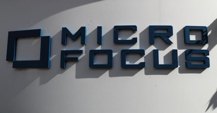 FILE PHOTO: A sign stands outside the offices of Micro Focus in Newbury