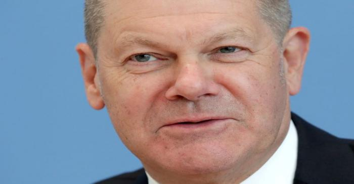 FILE PHOTO: German Finance Minister Olaf Scholz attends a news conference in Berlin