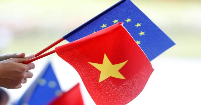 European Union and Vietnamese flags are seen at the signing ceremony of EU-Vietnam Free Trade