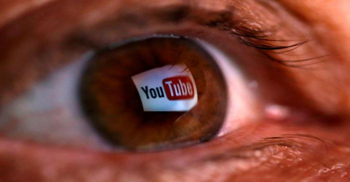 FILE PHOTO: A picture illustration shows a YouTube logo reflected in a person's eye, in central