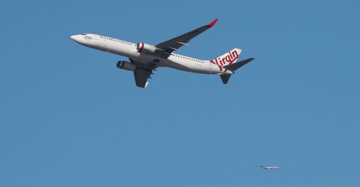 FILE PHOTO: A Virgin Australia Airlines plane takes off from Kingsford Smith International