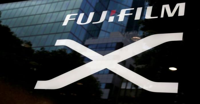 FILE PHOTO: Fujifilm's company logo is seen at its exhibition hall nearby the headquarters of
