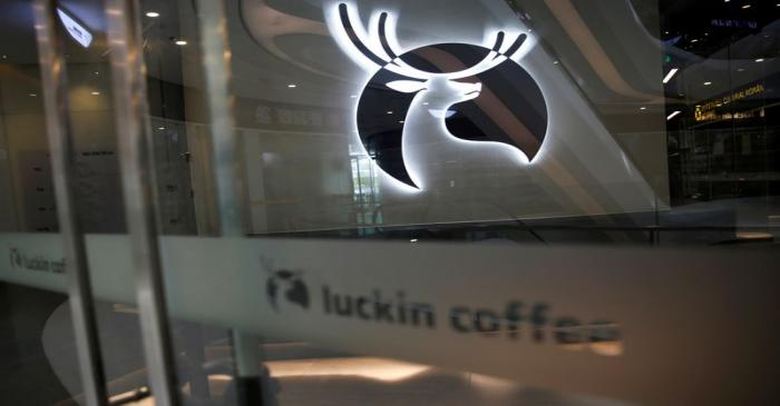 FILE PHOTO: A Luckin Coffee logo is seen at a store in Beijing