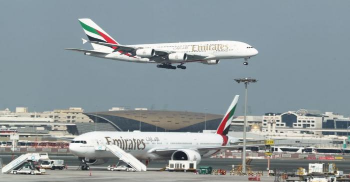 FILE PHOTO: Emirates Airlines Airbus A380 plane approaches for landing at Dubai Airports in