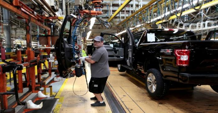 FILE PHOTO: A Ford Motor assembly worker works on a 2018 Ford F150 pick-up truck at Ford's