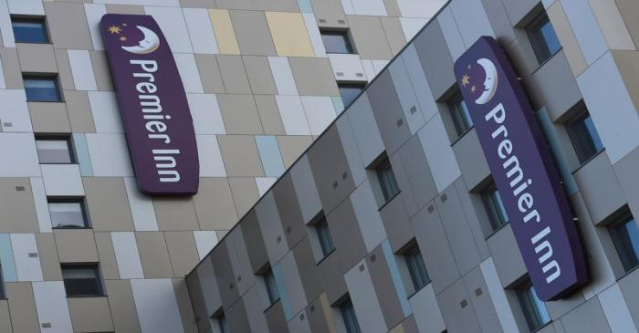 FILE PHOTO: Signage for Premier Inn is seen on the outside of one of their hotels in London,