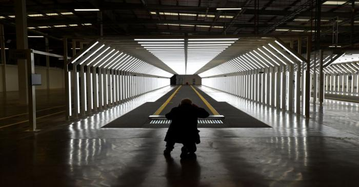A guest is pictured inside the new Aston Martin Lagonda factory in Saint Athan